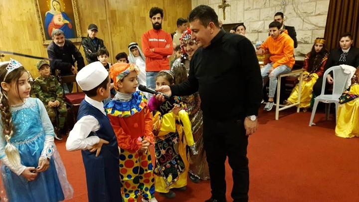 أطفال المهجّرين العراقيّين في الأردنّ يحيون تذكار القدّيسة بربارة